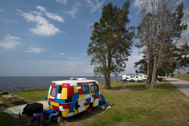 A camper at the Pahokee Marina and Campground on Lake Okeechobee in Pahokee, Florida on April 14, 2016. (Allen Eyestone / The Palm Beach Post)